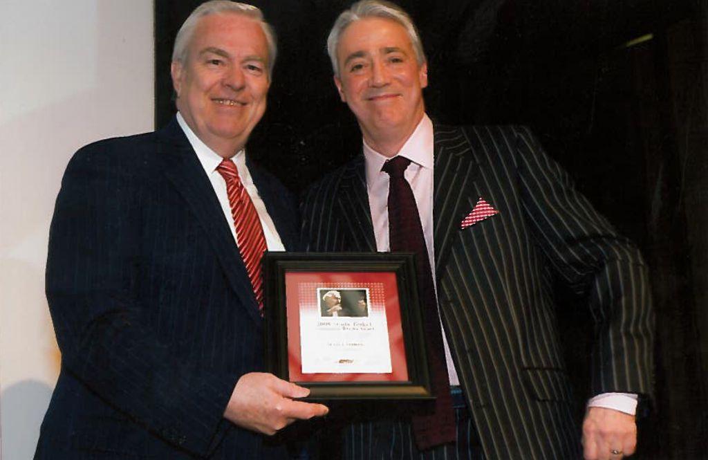 Bill Kurtis presenting Scott Simon with his 2009 Studs Terkel award.